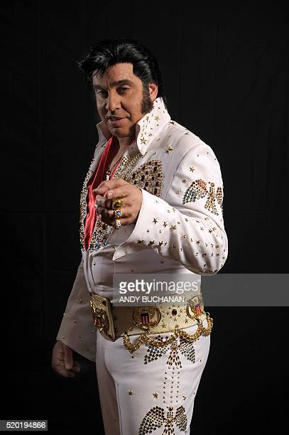 Elvis Presley impersonator Mario Kombou from England poses for a photograph backstage before performing at the first Scottish Elvis Festival on April...