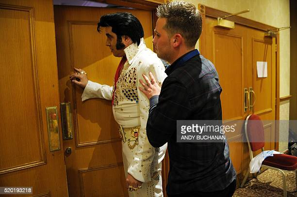 Elvis Presley impersonator Mario Kombou from England prepares to perform at the first Scottish Elvis Festival on April 9 2016 in Grangemouth The...