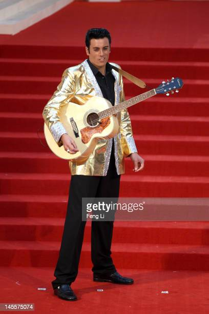 Elvis Presley impersonator performs outside the the Montblanc Sanlitun Concept Store during the Montblanc international gala to celebrate the...