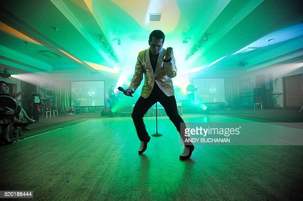 TOPSHOT Elvis Presley impersonator Ricky Aron from Liverpool performs at the first Scottish Elvis Festival on April 8 2016 in Grangemouth The...