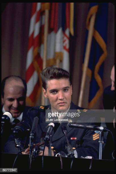 Elvis Presley in uniform at press conf on his last day serving in US Army