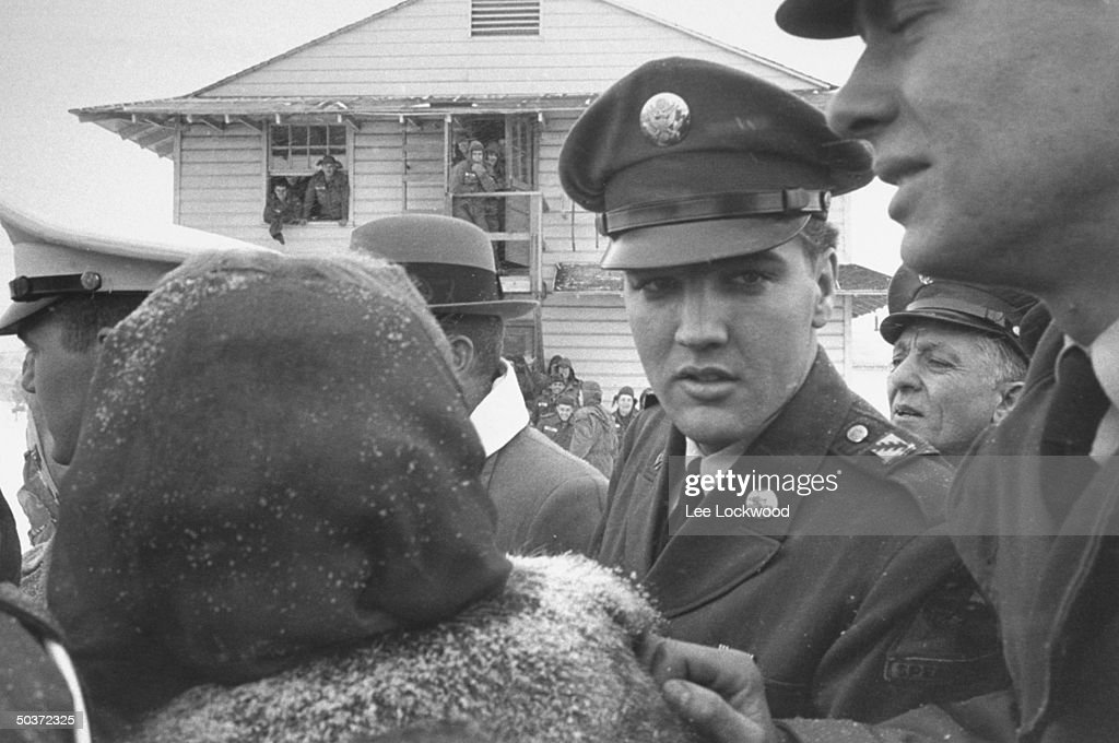 Elvis Presley (3R) in uniform on Army Base the day of his departure from service.