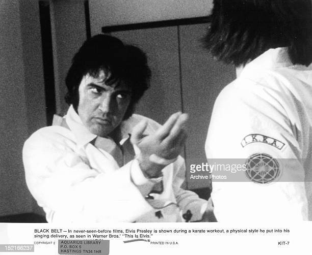 Elvis Presley is shown during a karate workout as seen in the film 'This Is Elvis' 1981