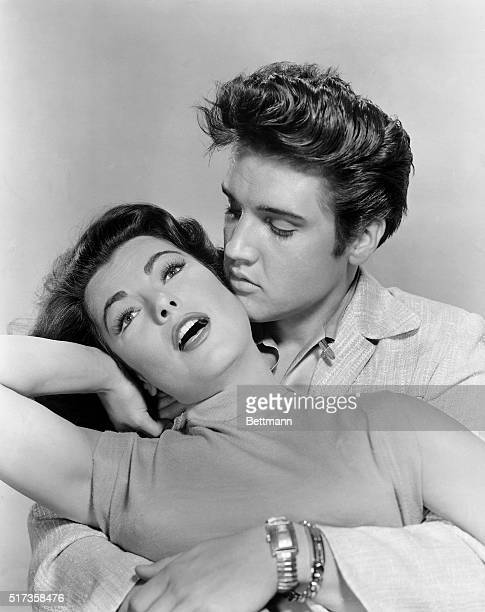 Elvis Presley is shown holding costar actress in a publicity handout from 'Jailhouse Rock' 1957 An Avon Production An MGM Release