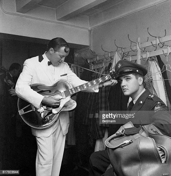 Elvis Presley Listens to Bill Haley Tune Guitar
