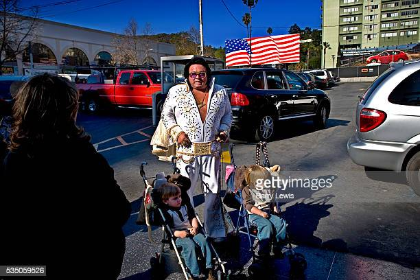 Elvis Presley lookalike posing with kids outside Mann's Chinese Theatre on Hollywood boulevard Wannabe actors and chancers pose for a dollar with...