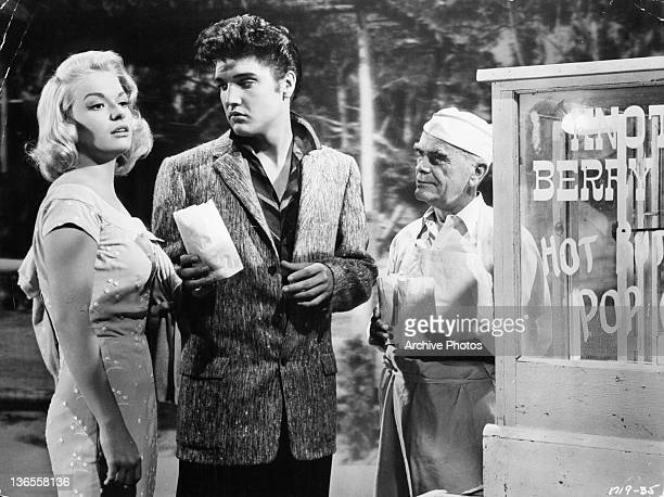 Elvis Presley offers unknown actress some popcorn in a scene from the film 'Jailhouse Rock' 1957
