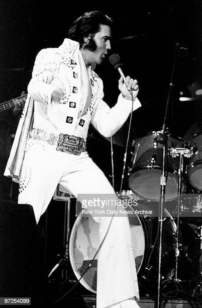 Elvis Presley on stage during a concert at Madison Square Garden.