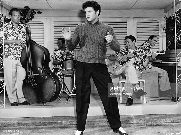 Elvis Presley on stage entertaining in a scene from the film 'Jailhouse Rock' 1957