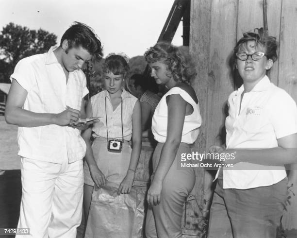 Elvis Presley on the set of 'Love Me Tender in August 1956 at the 20th Century Fox Ranch Malibu Creek State Park California Photo by Michael Ochs...