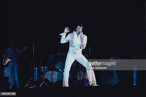 Elvis Presley Performing in White