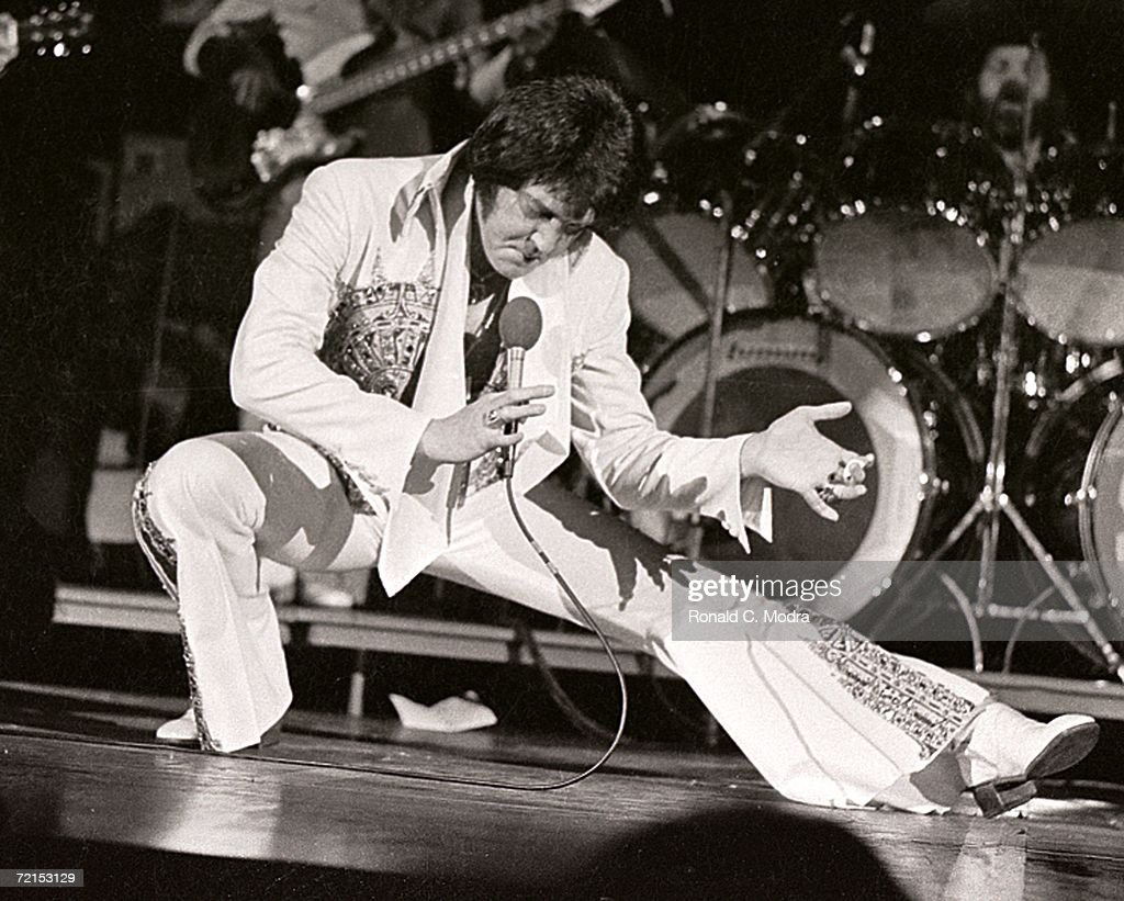 Elvis Presley performs in concert at the Milwaukee Arena on April 27, l977 in Milwaukee, Wisconsin.