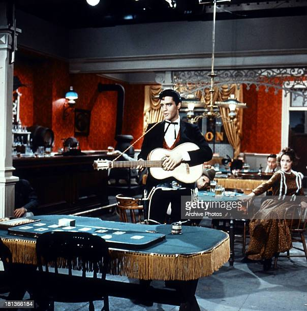 Elvis Presley plays guitar in a scene from the film 'Frankie And Johnny' 1966