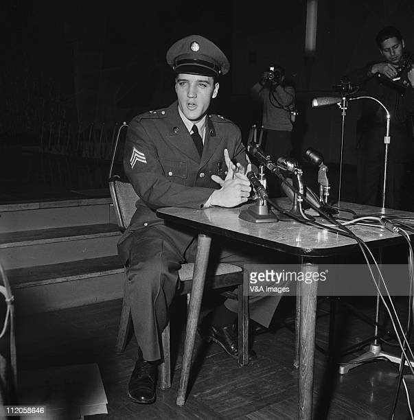 Elvis Presley posed in military uniform at Prestwick Airport in Scotland giving a press conference during only UK visit 3 March 1960