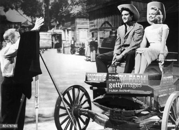 Elvis Presley poses on a wagon at Knott's Berry Farm in California circa 1955