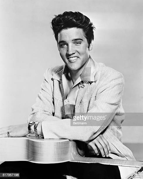 Elvis Presley poses with guitar in a promotional still for the movie 'Jailhouse Rock' circa 1957