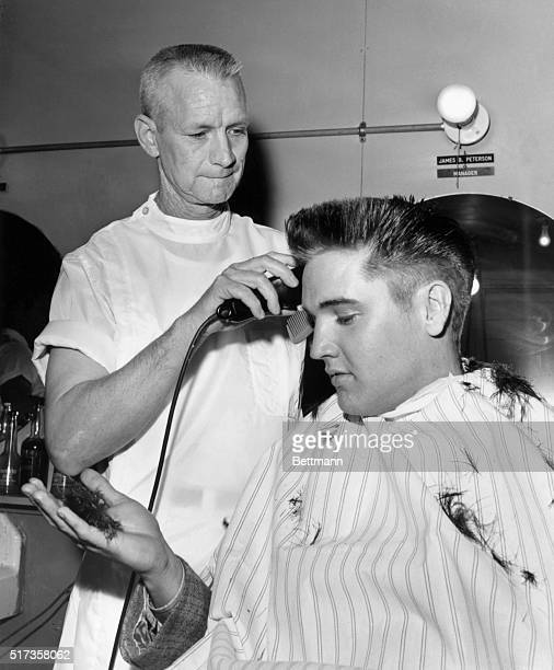 Elvis Presley receives a crew cut on his first full day as a member of the US Army