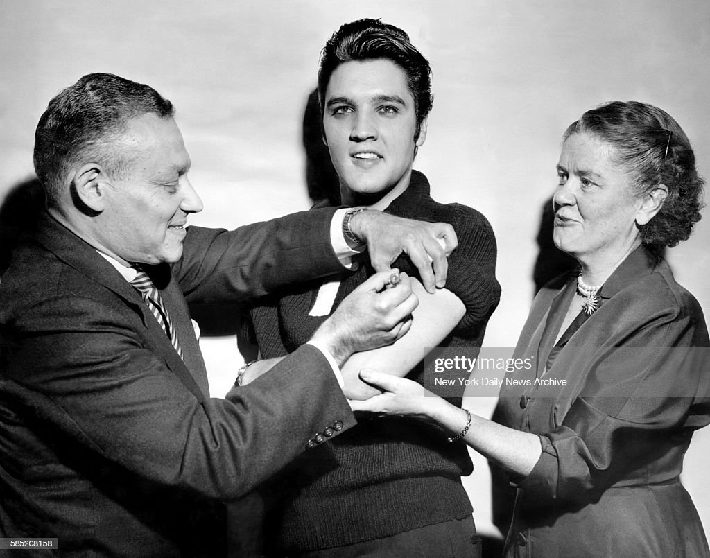 Elvis Presley receiving a polio vaccination from Dr. Leona B : News Photo