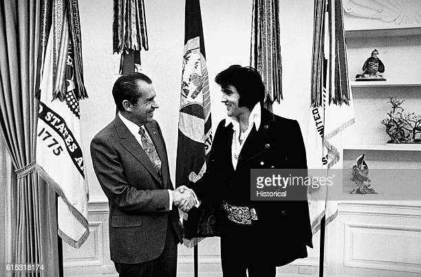 Elvis Presley shakes hands with President Richard Nixon at the White House in December 1970