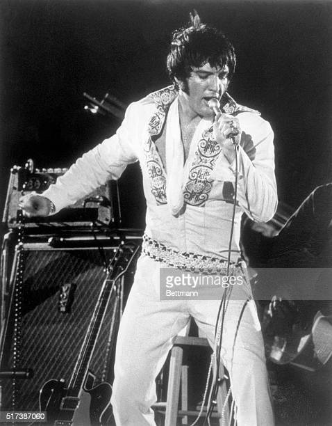 Elvis Presley sporting his new mod hairstyle is shown during his recent performance at the Houston Astrodome