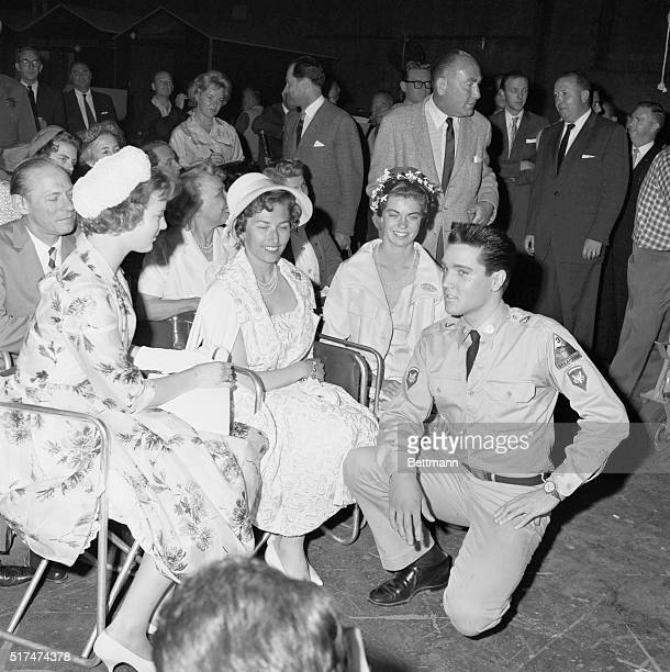 Elvis Presley takes a break from shooting GI Blues at Paramount Pictures Studios to meet with princesses Margrethe of Denmark Astrid of Norway and...