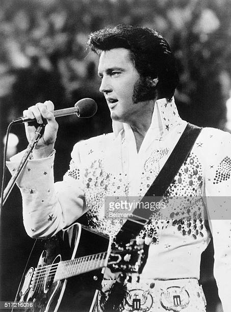 Elvis Presley the hipswinging truck driver who became the world's most famous rock n' roller died at his Graceland mansion 8/16 apparently of a heart...