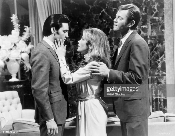 Elvis Presley US singer and actor with US actress Michele Carey and Dick Sargent in a publicity image issued for the film 'Live a Little Love a...
