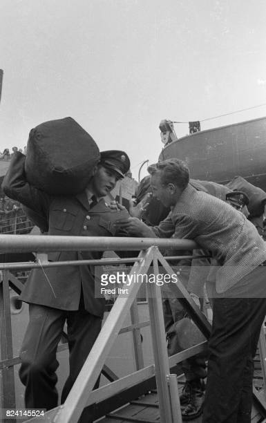 Elvis Presley walking off an army troop ship in Bremerhaven West Germany on Oktober 1 1958 He was 23 years old It was his first trip beyond North...