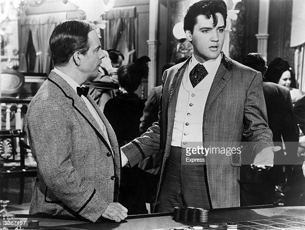 Elvis Presley with Harry Morgan in a scene from 'Frankie And Johnny' a musical about girls and gambling based on an English folk ballad