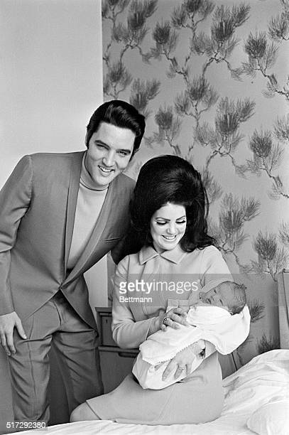 Elvis Presley with Priscilla and their four day old daughter Lisa Marie prepare to leave Baptist Hospital in Memphis Tennessee