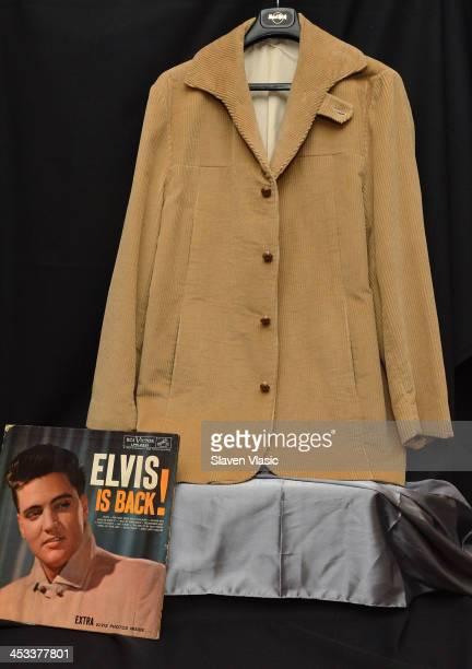 Elvis Presley's 1960 Elvis is Back album cover worn tan corduroy jacket on display at Icons Idols Rock n' Roll on December 3 2013 in New York City