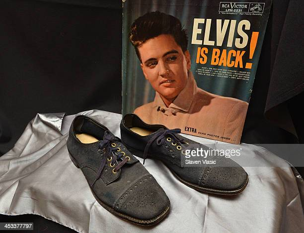 Elvis Presley's blue suede size 10 shoes from 1960 on display at Icons Idols Rock n' Roll on December 3 2013 in New York City