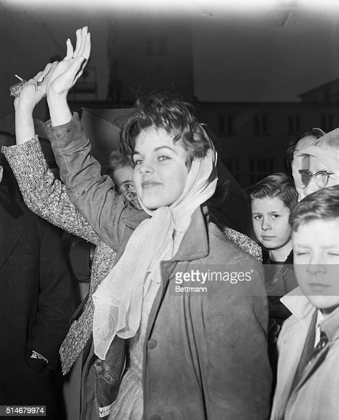 Elvis Presley's girlfriend Priscilla Beaulieu waves goodbye to Elvis as he departs from RhineMain air base February 2 1960 to return to the United...