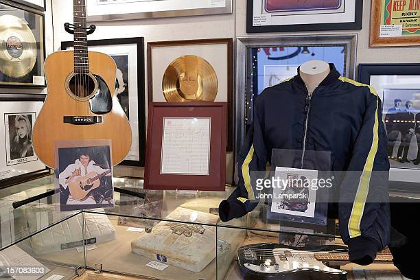 Elvis Presley's last stage used guitar John Lennon's last autograph and Michael Jackson's jacket worn on first meeting with Nelson Mandela displayed...