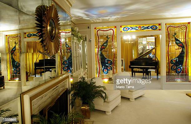 Elvis Presley's living room at Graceland is seen during Elvis Week on August 12 2002 in Memphis Tennessee 75000 fans are expected to attend the...