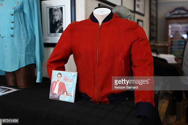 Elvis Presley's red suede jacket worn on Jailhouse Rock 45 cover and promotional photos on display at the rock roll music memorabilia auction press...