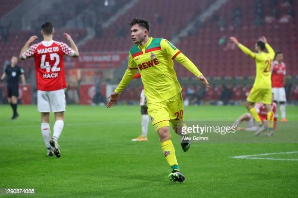 Elvis Rexhbecaj of 1. FC Koeln celebrates after scoring his team's first goal during the Bundesliga match between 1. FSV Mainz 05 and 1. FC Koeln at...