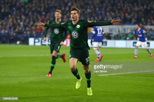 Elvis Rexhbecaj of VfL Wolfsburg celebrates after scoring his team's first goal during the Bundesliga match between FC Schalke 04 and VfL Wolfsburg...