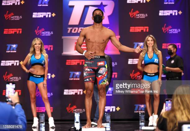 Elvis Rodriguez flexes on the scale ahead of his fight with Kenneth Sims Jr at Virgin Hotels Las Vegas on May 21, 2021 in Las Vegas, Nevada.