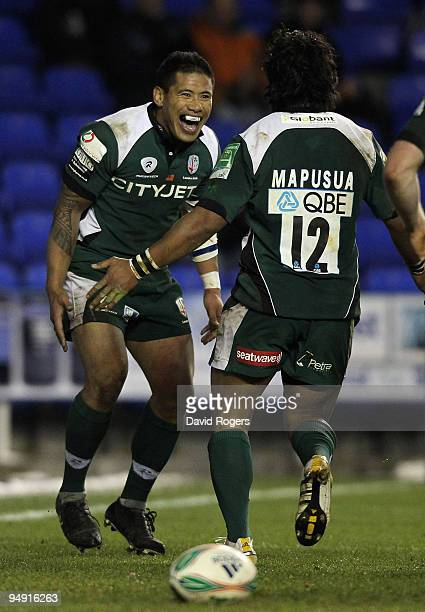 Elvis Seveali'i of London Irish celebrates after scoring a try with teammate Seilala Mapusua during the Heineken Cup match between London Irish and...