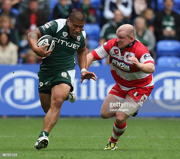 Elvis Seveali'i of London Irish races away from Scott Lawson during the Guinness Premiership match between London Irish and Gloucester at the...