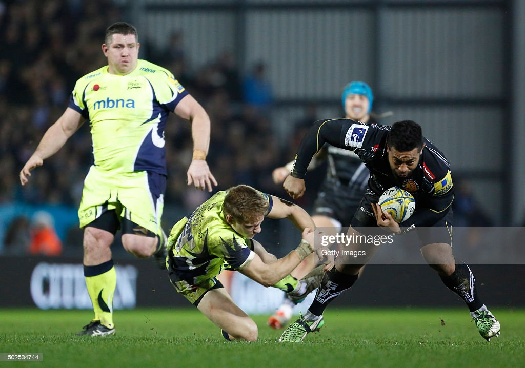Elvis Taione of Exeter Chiefs avoids Mike Haley of the Sale Sharks during the Exeter Chiefs v Sale sharks Aviva Premiership Match at Sandy Park on December 26, 2015 in Exeter, England.