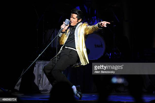 Elvis tribute artist Dean Z performs onstage during the 'Elvis Lives' tribute concert at City National Grove of Anaheim on March 16 2015 in Anaheim...