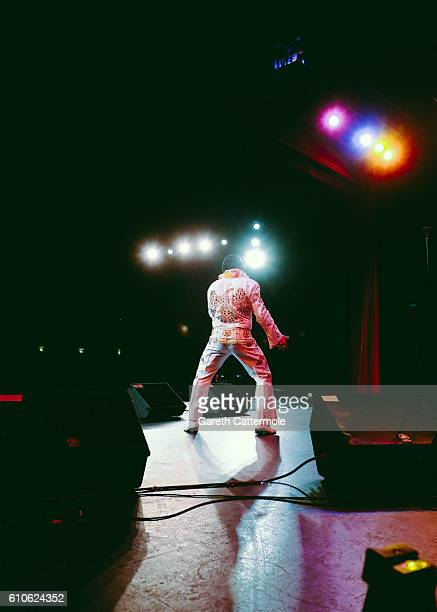 Elvis tribute artist Lee Alexander performs on stage as part of the Best Festival Elvis Competition at the Grand Pavillion during 'The Elvies' on...