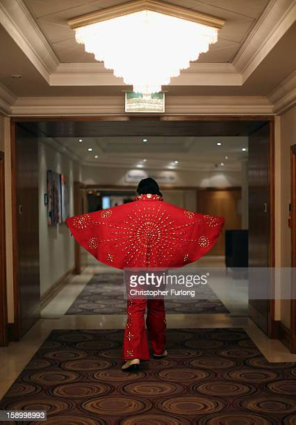 Elvis tribute artist Pat David Bishop poses as he waits to perform during the European Elvis Championships at the Hilton Hotel on January 5 2013 in...