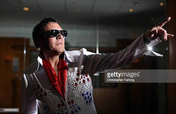 Elvis tribute artist Pat McDonnell poses as he waits to perform during European Elvis Championships at the Hilton Hotel on January 5 2013 in...