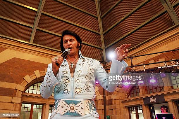 Elvis tribute artist Ross Mancini performs at Central Station prior to boarding the 'Elvis Express' on January 7 2016 in Sydney Australia The Parkes...