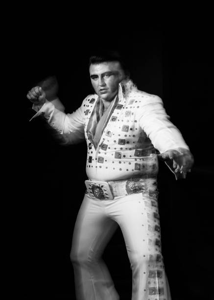 Elvis tribute artist Steve Knight a bricklayer from London poses during...