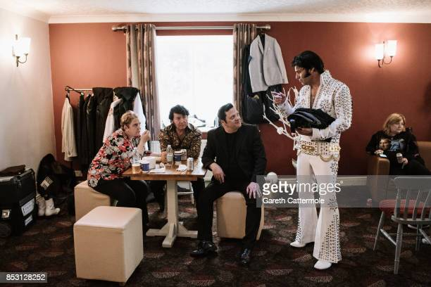 Elvis tribute artists prepare backstage ahead of perfroming at 'The Elvies' on September 24, 2017 in Porthcawl, Wales. 'The Elvies' is an annual...