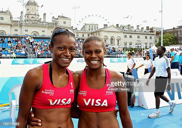 Elwin Miller and Linline Matauatu of Vanuatu celebrate after winning their Preliminary Phase Pool B match against Holland during the VISA FIVB Beach...